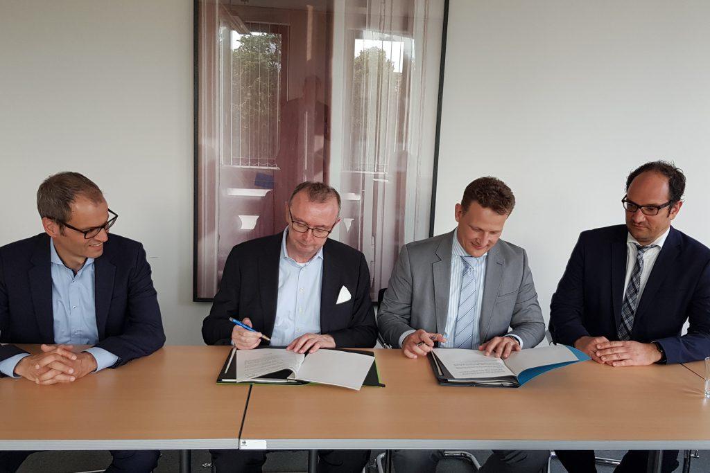 v.l.n.r.: MD Frank Krüger (BMVI), MR Rudolf Boll (BMVI), Dr. Jan Tulke (pb40), RD Heiko Roeder (BMI)